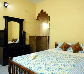 ideal ayurvedic resort bed room 2